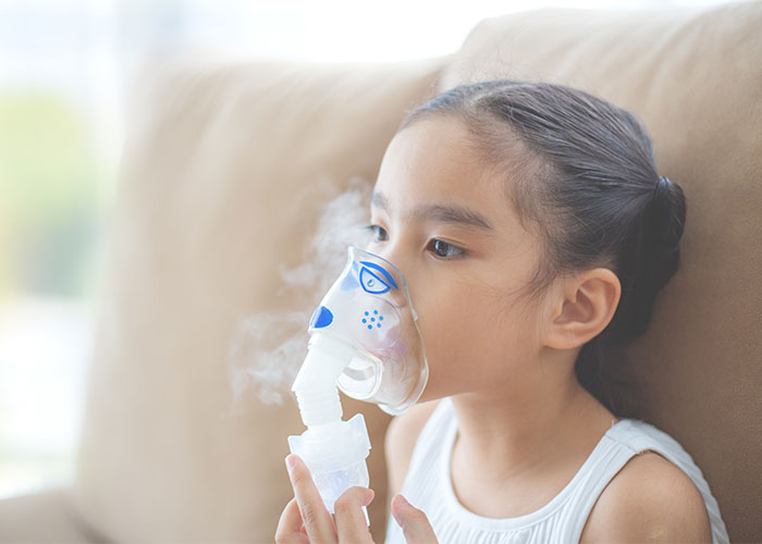 Image of young girl using respiratory equipment